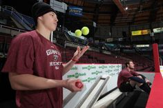 Payton Lee working on hand-eye coordination during warm-up. Photo Credit, Boards, Warm, Eye, Planks