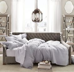 Restoration Hardware Baby & Child Daybed---I could see this in a guest room that is having a spacial issue.  Couch by day, bed by night.  Also, check out the pendant light above.  Not to mention those gorgeous mirrors.