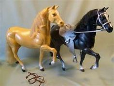 Had the black horse with saddle and everything...and a white horse too!