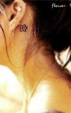 Flower tattoo behind the ear