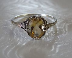 Hey, I found this really awesome Etsy listing at https://www.etsy.com/listing/181866363/lovely-sterling-silver-art-deco-citrine