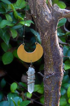 Lovely bold mystical necklace created with a large brass crescent moon and a wire wrapped Quartz crystal point. Crescent and gemstone hang from