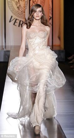 eda3b31fb7 Haute couture  Versace s long evening gowns in pastel shades featured  corseted waists and split skirts