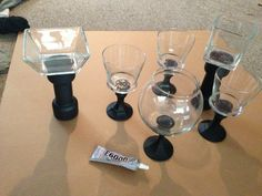Easy DIY candy bar containers. Found glass bases ( candle stick holders) at the thrift shop and dollar tree. Painted bases flat black and glued various glass containers for candy using e6000 glue. ( Black for superhero theme).