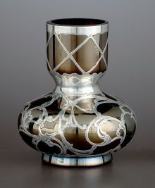 AN AUSTRIAN GLASS BUD VASE WITH SILVER OVERLAY