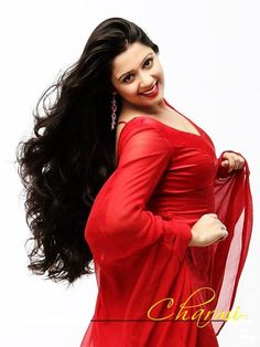 Charmi Kaur in Red Dress Open Hair Stylish and Smiling Pose