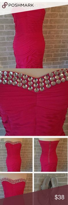 """BNWT Sparkle Beaded Neckline Strapless Dress Brand New with Tags! Tag says size Large but please refer to measurements. I had my sister model this. She is a 4/6 and 5'9"""" so it's short on her. Date Night Host Pick 6/14/14! Firm Laying flat measurements are:  Pit to pit- 16.5 Waist- 14 Length-27.5 Dresses Mini"""
