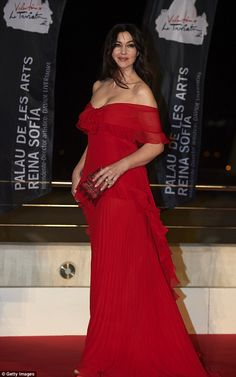 Ravishing in red: Monica Bellucci, 53, stole the show when she attended the premiere of La Traviata at the Palau de Les Arts Reina Sofia in Valencia, Spain on Thursday evening