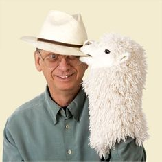 "Alpaca Stage Hand Puppet   Click to enlarge               Alpaca Stage Hand Puppet  The fluffy fleeced Alpaca Stage Puppet has sweet and gentle features offset by woolly super-soft plush and wise eyes that say, ""I don't need a sweater""!   www.purelyalpaca.com"