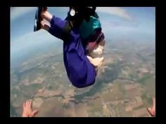 Lady Slips Out of Harness When Skydiving - TURN ON MUTE, music sucks but this is awful! Thank God she lived to tell about it!