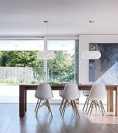 Foscarini Caboche and Eames Dining chairs