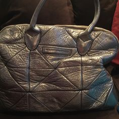 Marc Jacobs silver handbag Authentic Marc Jacobs metallic handbag with gold hardware - it is in good shape but used and could use an interior cleaning Marc Jacobs Bags