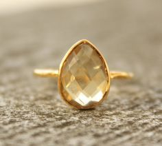 This is pretty much what I had in mind for my wedding ring. I love citrine more than any other stone!.
