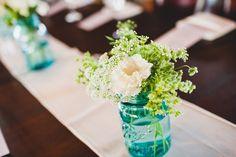 Turquoise mason jars make fine vases/centerpieces