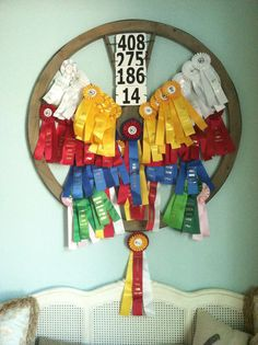 Display of horse show ribbons on a wagon wheel purchased from One King's Lane.  Worked out well!