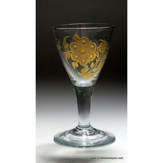 Heading : Gilded and Engraved Glass Date : c1760 Period : Charles III Origin : Spain Colour : Clear Bowl : Conical Bowl Features : Engraved and Gilded with rose and leaves Stem : Plain Foot : Conical Pontil : Snapped Type : Soda Size : 4 1/2 inches tall with a 2 3/8 inch bowl and 2 3/8 inch foot    Condition : Excellent, no chips or cracks. It has two air bubbles in the bowl as shown. Restoration : None Weight: 80 grams Port Wine Glasses, French Wine, Wines, Soda, Period, Restoration, Spain, Bubbles, Chips