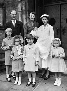 Duke and Duchess of Grafton, HM The Queen holding her goddaughter Lady Virginia, Viscount Ipswich, Lady Henrietta FitzRoy, The Prince Charles and The Princess Anne