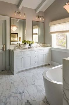 elegant marble bathroom- in the link there are several great ideas, marble, ivory and basket weave