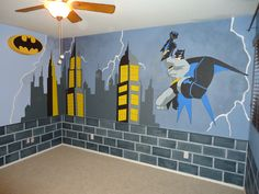 Batman Room Makeover - Started with blue walls.  Brick is painted throughout the bottom border of the room and Batman is swinging from a yellow rope! Check our more murals and items for sale at Kid Murals by Dana Railey on FB!