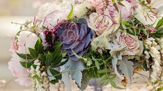 Love the idea of a pop of color and texture from a succulent in either/both the bouquets and table centerpieces. Maybe a red-tipped succulent...