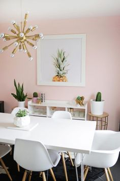 Blush pink walls in the dining room. So soft and feminine with out being overpowering.