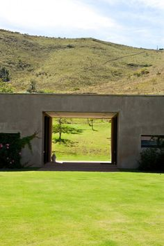Herman describes the shape of a sleeping dragon nestled in the mountains. In keeping with a Feng Shui philosophy, he intentionally left a hole in the building to allow the beast a clear view of the landscape. Minimal Architecture, Landscape Architecture Design, Interior Architecture, Interior And Exterior, Landscape Arquitecture, Barn Renovation, Landscaping Software, Architectural Elements, House Design