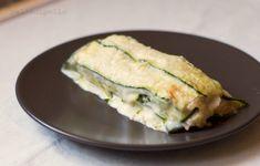 Gustosa parmigiana di zucchine con prosciutto cotto, provola e besciamella. Ricetta semplice e leggera, con zucchine cotte al forno, non fritte.