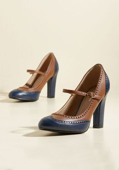 Be the First to Pro Heel - Your peers may be on fast-moving career paths, but there's no way they're succeeding as stylishly as you are in these Oxford heels! Combining brown and navy blue hues with Mary Jane straps and classy perforations, these wowing faux-leather wingtips pairs well with your great work ethic.