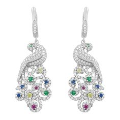 Unique and fashionable. The majestic glow of colored cubic zirconia stones and sterling silver accents the beauty of this peacock earrings to perfection.