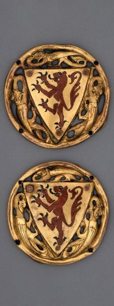 Heraldic Roundel, French (Limoges), Medieval, third quarter of 13th century -- Three ajoure modeled dragons fill spaces in circle (four holes for fastening) left by shield of red rampant lion of Leon with black claws. (well known in Spanish Castille and Leon coat of arms)