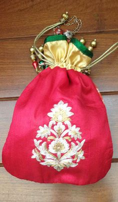 #Bags - Red & Golden Embroidered Potli Bag Costs Rs. 1,800. #Apparels. BUY it here: http://www.artisangilt.com/red-beige-embroidered-potli-bag.html?ref=pin