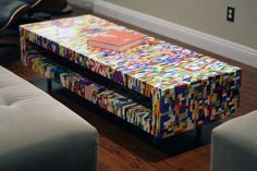 Lego Coffee Table gives me the idea of making a storage or kids cubby with the Lego building flat mats as the surface in order to maximize storage by being able to put the pieces on the outside as well as the inside.