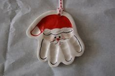 Santa Salt Dough Ornament: How Adorable is this Salt Dough Handprint Ornament! So easy to make too.. 1/2 Cup Salt, 1/2 Cup Flour, 1/4 Cup Water (give or take) Knead until dough forms. Make impression and cut out hand shape with a knife leaving a border. Poke a hole in top for hanging. Bake at 100C/200F for 3 hours. Paint, Seal and ready to hang :)