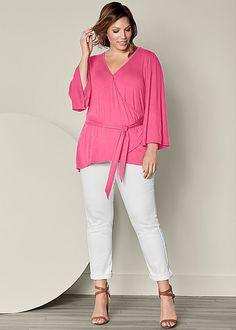 Pink perfection! Venus plus size belted surplice top.