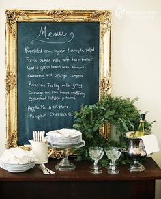This gold framed chalk board looks extremely decadent and works well as a wedding menu board.