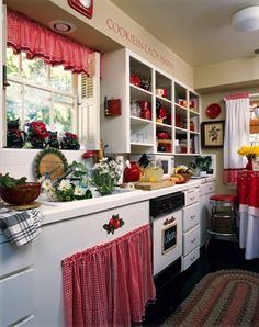 red and white kitchen cuteness  Love the drapes under the sink