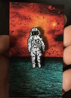 Astronaut enamel pin.