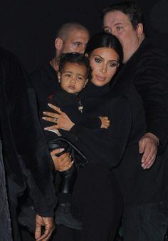 Kim Kardashian, Kanye, & North West attend the Balenciaga show during Paris FashionWeek.