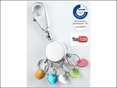 Key-holder, round, matt chrome, with carabiner, 5 exchangeable rings with coloured chips in order to distinguish the keys - Nettogewicht: 52.50 gr.