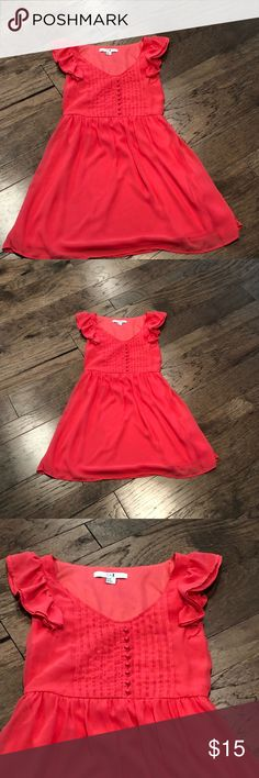 Coral pink Forever 21 dress Coral pink Ruffle sleeves, fully lined, button detail down front. Looks like it had a belt because there are belt loops on the back. In excellent condition! 32' length, 30' chest. Forever 21 Dresses