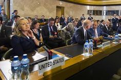 US Secretary of State Hillary Clinton (L) sits next to British Foreign Secretary William Hague (4th R), Russian Foreign Minister Sergei Lavrov (3rd R), and French Foreign Minister Laurent Fabius (2nd R) at the start of a crisis meeting on Syria at the United Nations office in Geneva