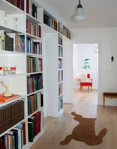 it doesn't take up much space...books all in one place...and it decorates a bare wall