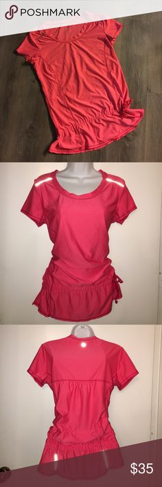 LISTING✨ Athleta Top Adorable work out too. Cinched at the hips and a discreet zipper pocket on the lower back. Loose fitting. Worn once but not signs of wear. This top is a coral color, refer to first photo(no flash). The 2nd-4th pix were taken with flash. Athleta Tops Tees - Short Sleeve