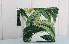 Stylish, hip, and most of all, useful! Our zippered Banana Leaf pouch is the perfect companion to your beach bag or as a standalone toiletry bag. Pouch is lined with durable PUL (Polyurethane Laminate) so its perfect for stowing toiletries, wet items and accessories. Bring it to the beach, camping, traveling...wherever. Protect your electronics, phones, books or camera in this water repellant bag. Its so versatile and lightweight and the waterproof lining is super easy to clean...just wipe…