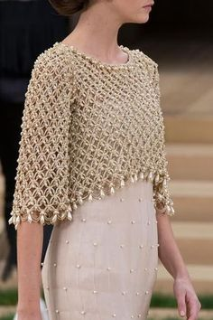 View all the detailed photos of the Chanel haute couture spring 2016 showing at Paris fashion week.  Read the article to see the full gallery.