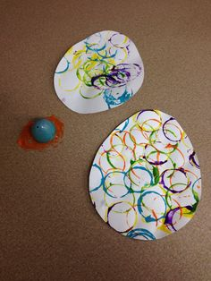Painting eggs with plastic eggs