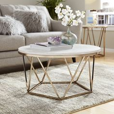 This art deco Coffee Table with a metal base triangulates its way to the round, faux stone tabletop, crafting a modern glam look. Find your style angle with this modern, round coffee table in your living room or den. Art Deco Coffee Table, Art Deco Table, Round Glass Coffee Table, Small Coffee Table, Round Coffee Table, Decorating Coffee Tables, Coffee Table Design, Coffee Coffee, Coffee Beans
