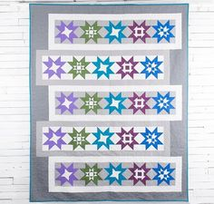 Chorus Line Quilt Kit by Debbie Caffrey featuring Boundless Solids Fabric | Craftsy. Star quilt kit. Modern quilt. Modern quilt kit. affiliate link.
