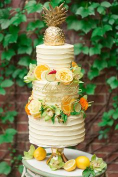 Dreaming of Summer With Citrus Wedding Cakes ~ Oranges, lemons and limes and flowers adorn this yellow beauty by The Dessert First Bakery