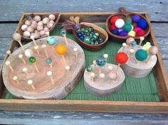 "Lovely choice of materials to develop fine motor skills - marbles, cedar balls, felted balls & tree slices...  from Fingadingadoo ("",)"
